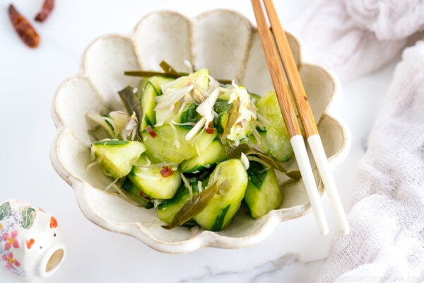 A flower shaped ceramic containing Pickled Cucumbers and Myoga.