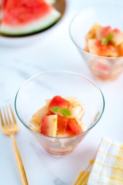 A round glass bowl containing Pickled Watermelon Rind.