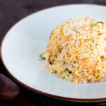 Salmon Fried Rice on a white plate.