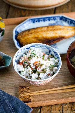 A rice bowl containing Ume and Shiso Rice served with mackerel and miso soup.