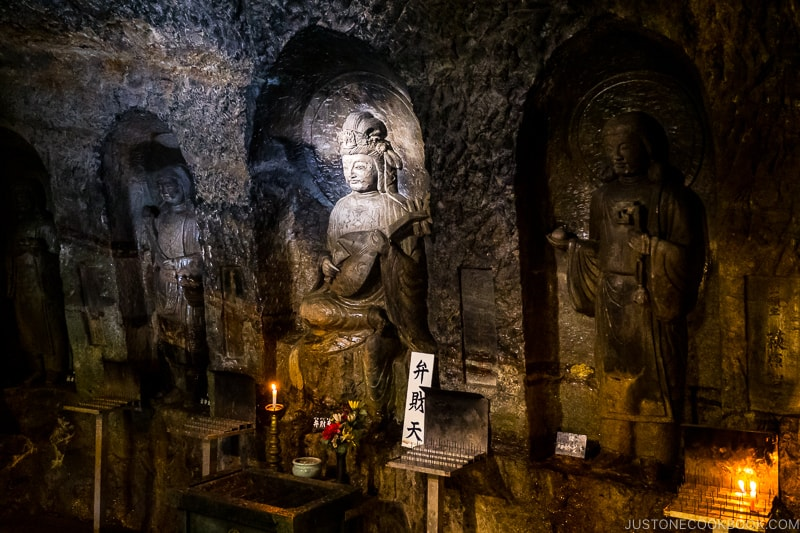 statues of deity inside a cave