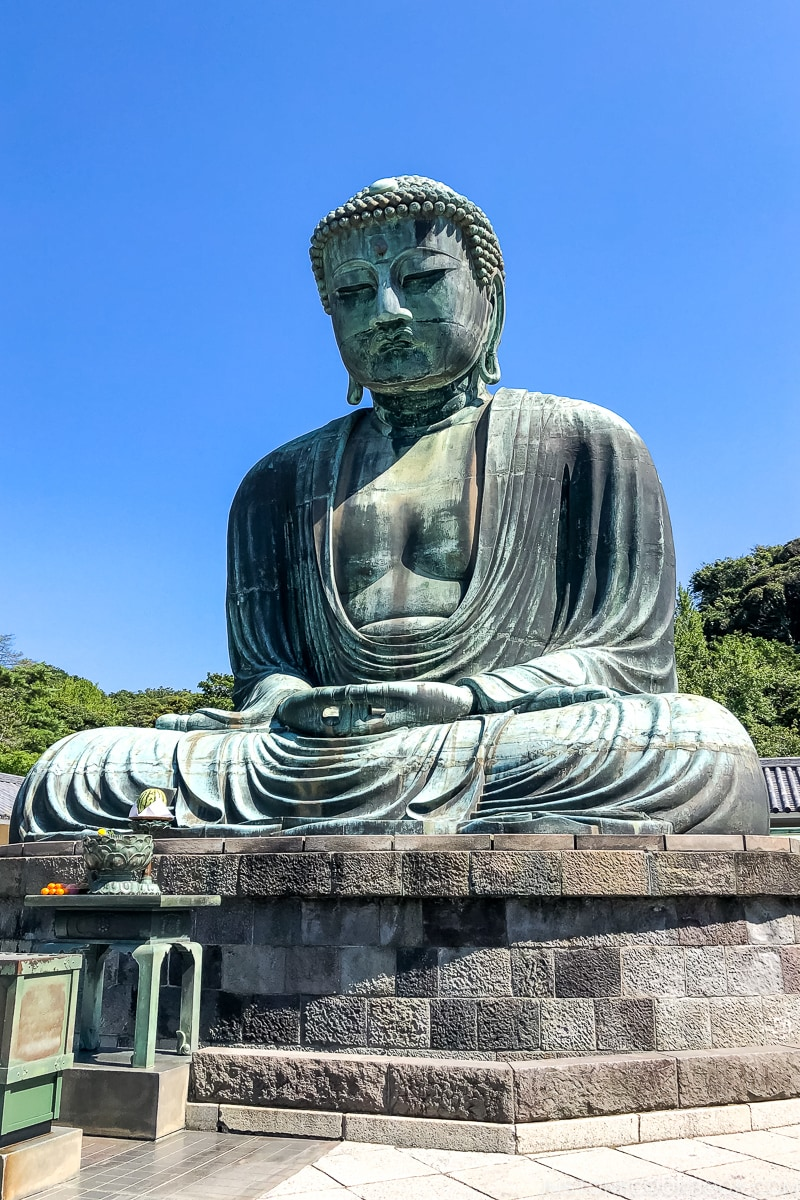 giant Buddha statue on top of stone pedestal