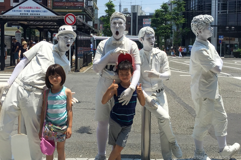two children with people covered in white paint