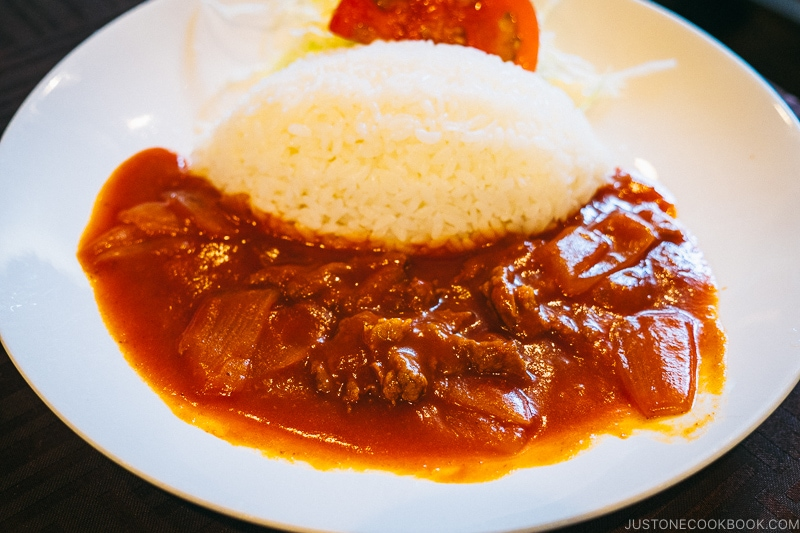 beef curry on a white plate