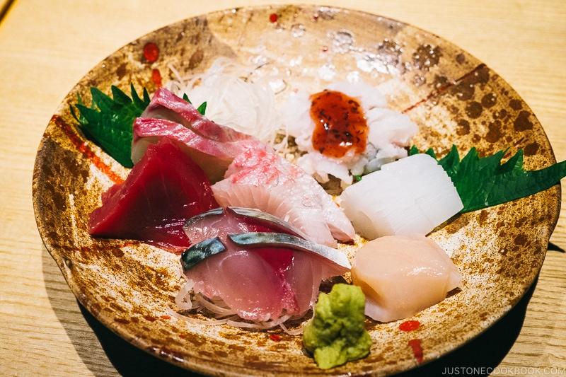 assorted sashimi on a earthenware plate