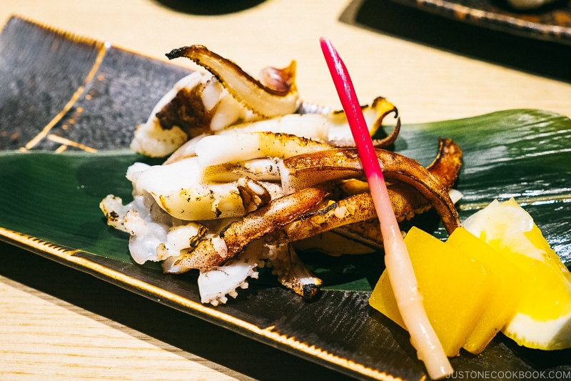 grilled squid legs on bamboo leaf