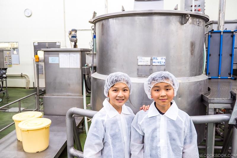 children standing in front of machines