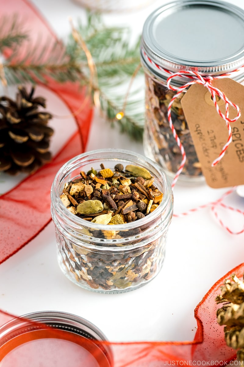 A mason jar containing Mulling Spices for Hot Mulled Cider.