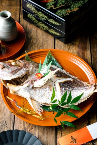 A lacquer tray containing a whole Japanese Baked Sea Bream.