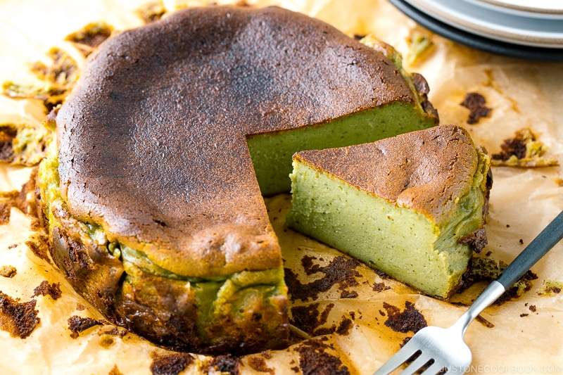 A Matcha Basque Burnt Cheesecake on top of the parchment paper.