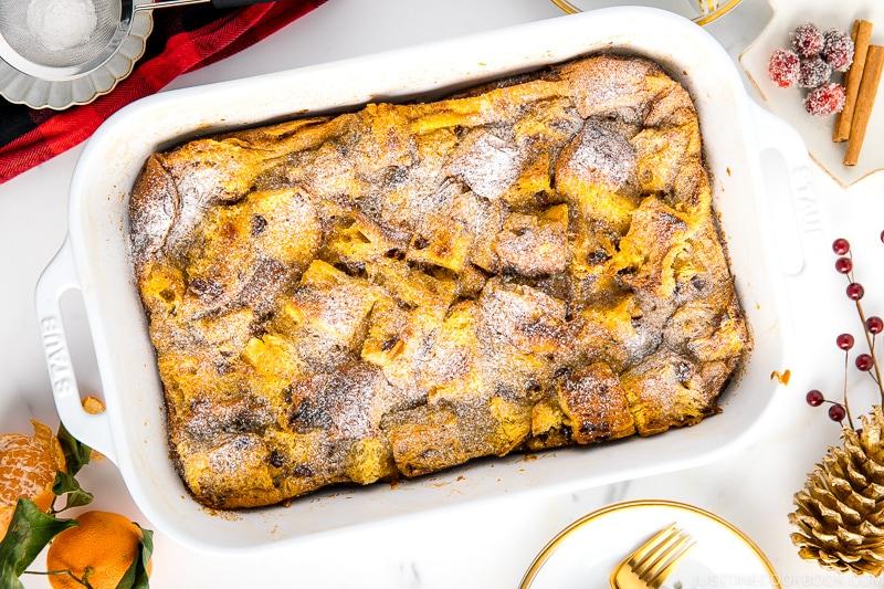 A white casserole dish containing Panettone Bread Pudding.