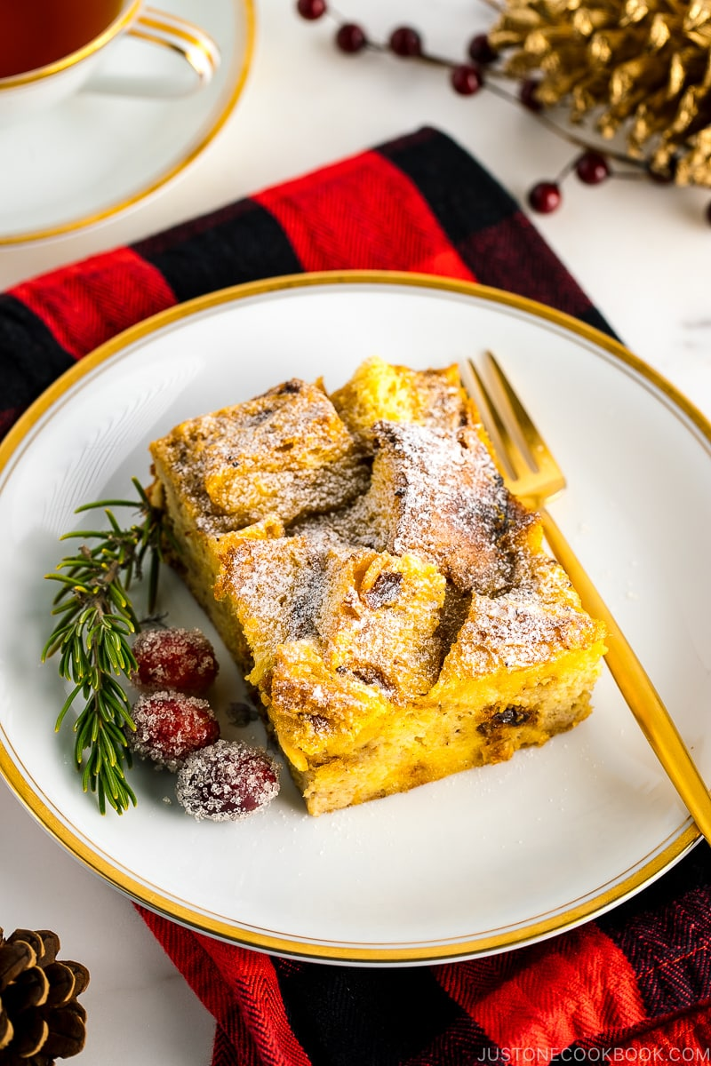 A plate containing a slice of Panettone Bread Pudding.