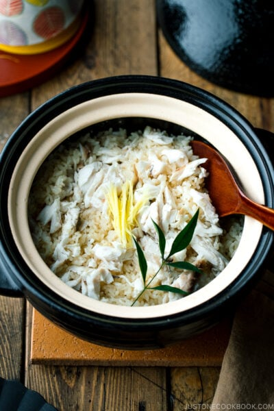 A Kamadosan (Japanese donabe) containing Tai Meshi (Japanese Sea Bream Rice) garnished with julienned ginger.