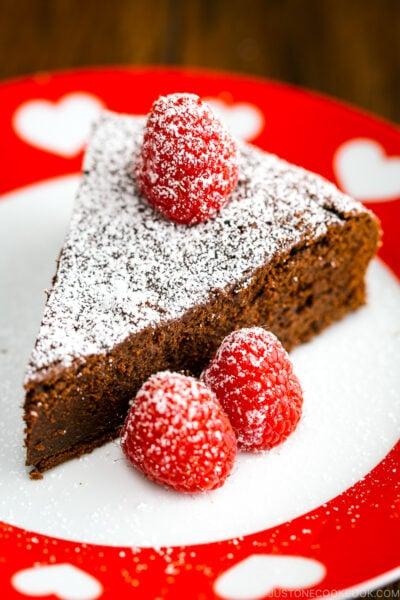 A slice of Chocolate Gateau (Chocolate Cake) on a plate.