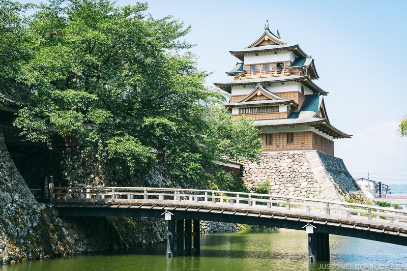bridge over a moat with Takashima Castle in the back