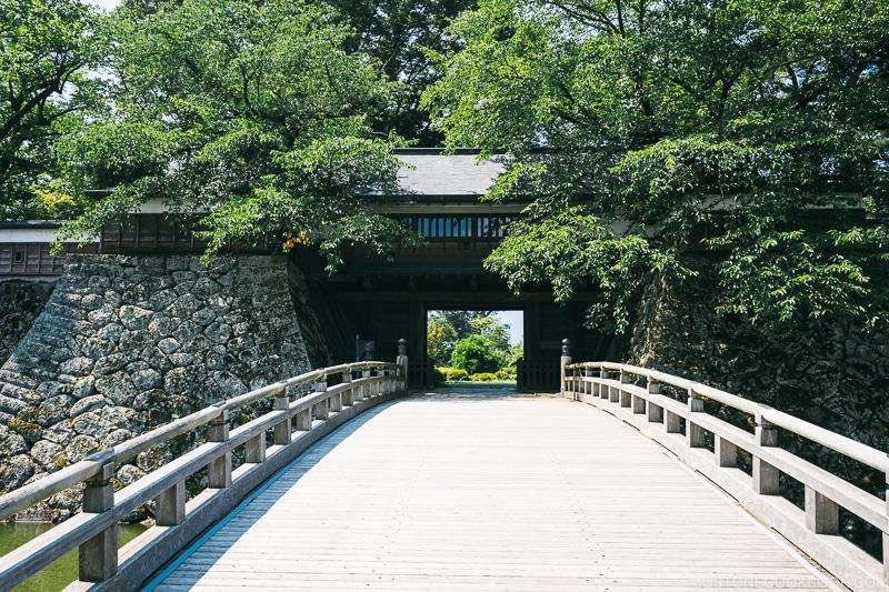 a bridge leading to a gate