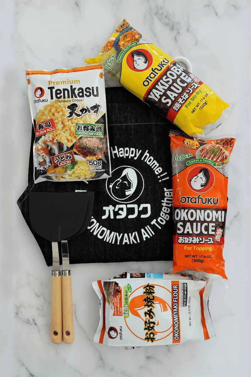 Otafuku gift set featuring okonomi sauce, yakisoba sauce, apron, a set of spatula
