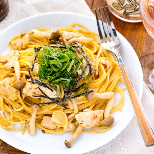 A white plate containing ume shiso pasta.