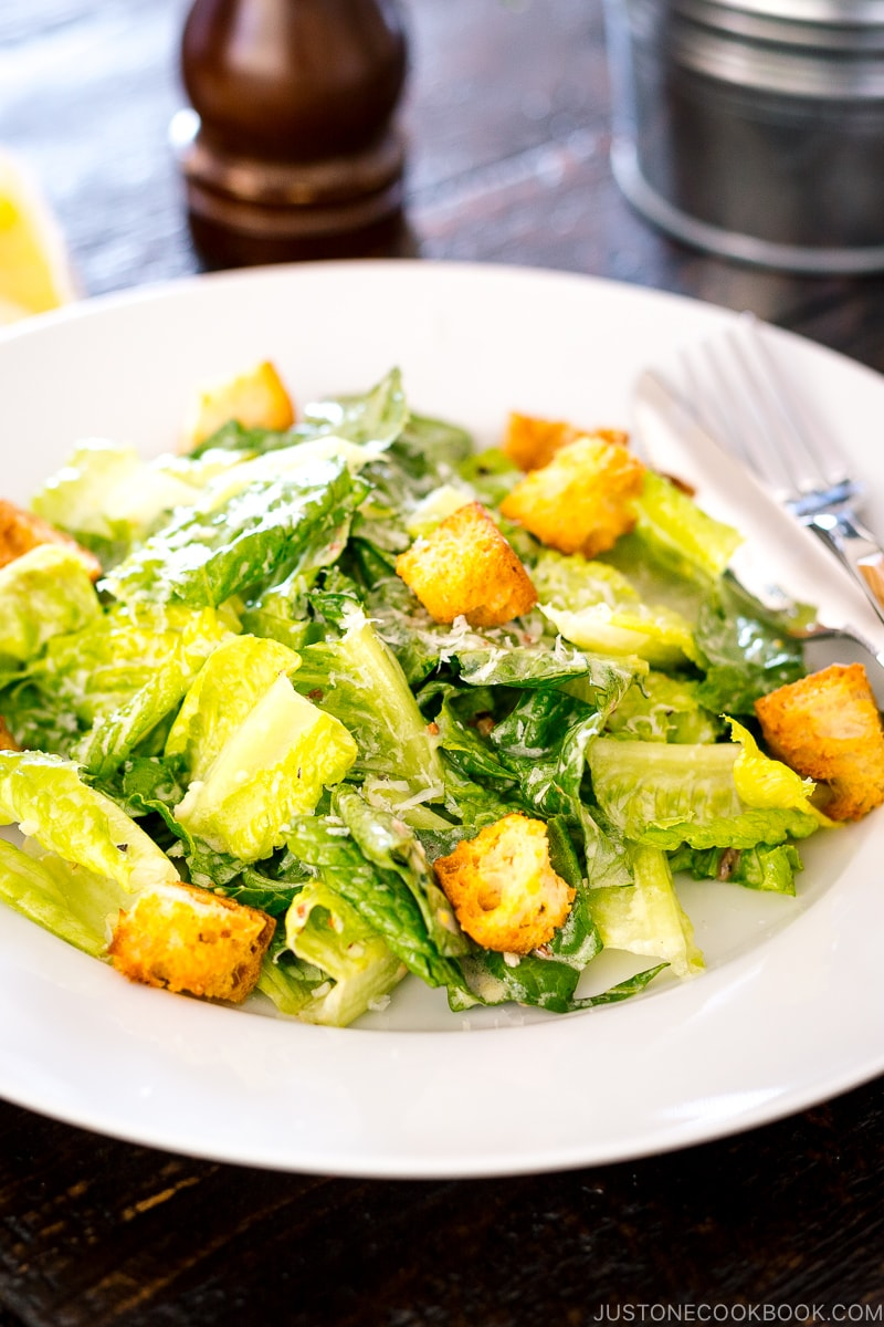 A white plate containing Caesar Salad with Homemade Croutons.