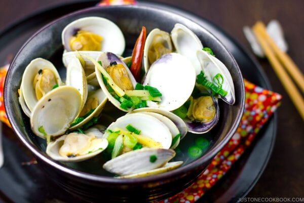 A black bowl containing Japanese Sake-Steamed Clam.