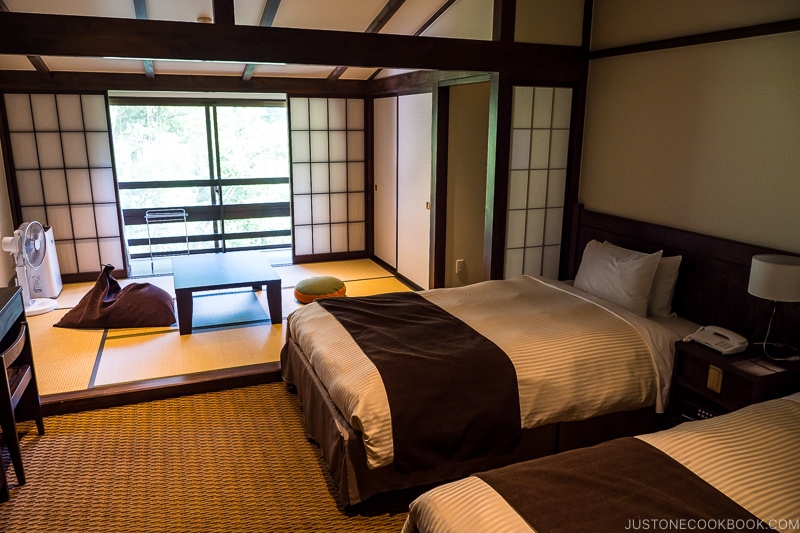 guest room at Kamikochi Alpen Hotel with two beds and tatami sitting area