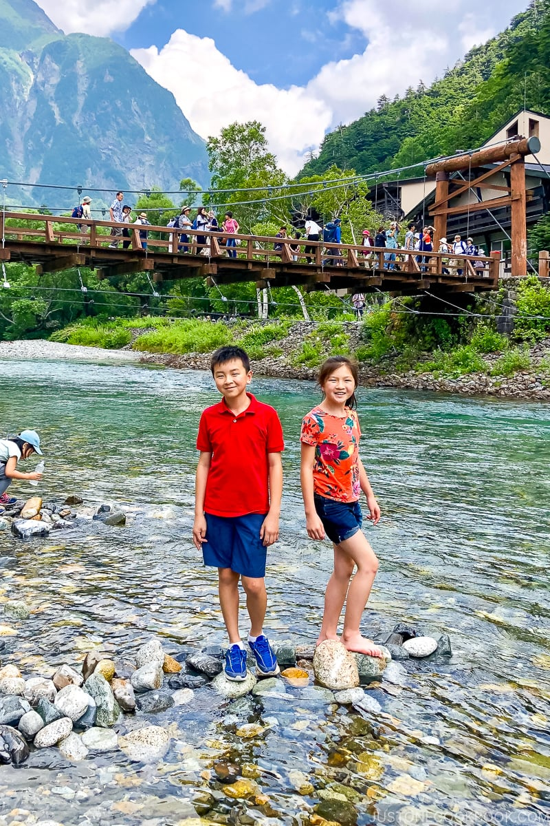 two children in Azusa River with Kappa Bridge in the background