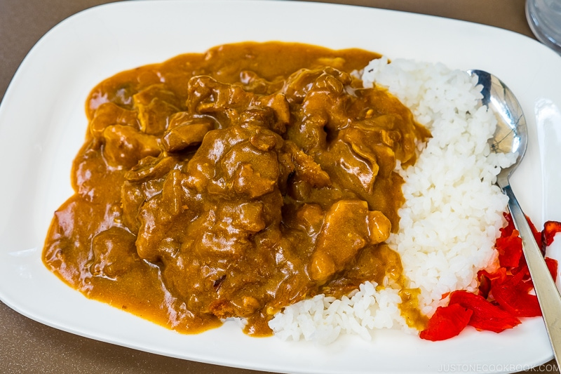curry on rice served in a white plate