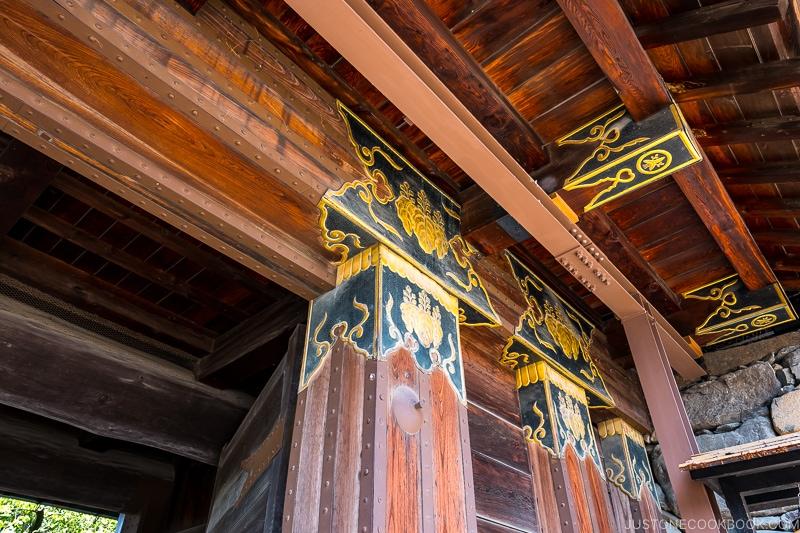 intricate wood work and decoration on Matsumoto-jō Kuromon