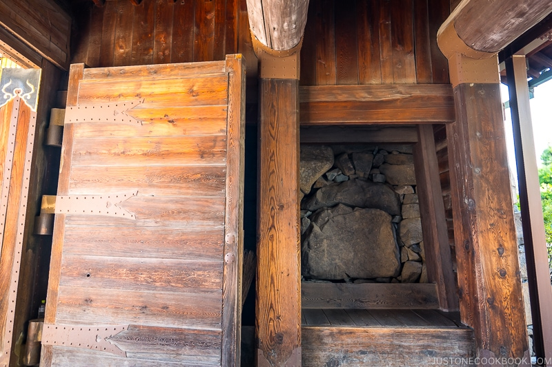 wooden gate with inside of castle wall exposed