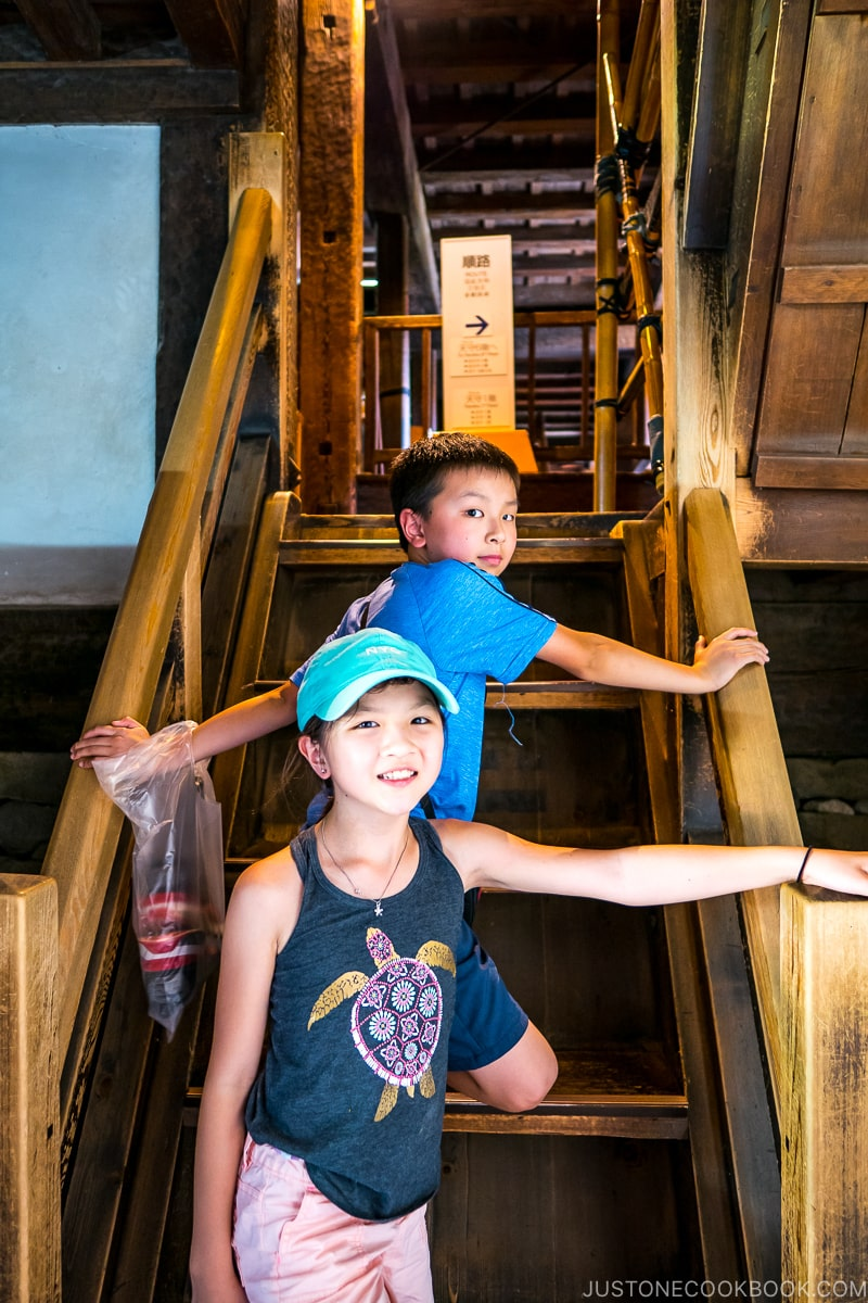 two children on wooden stairs