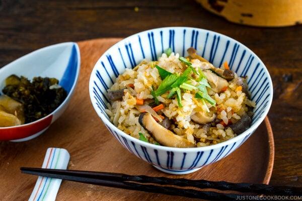 A Japanese blue and white rice bowl containing Takikomi Gohan (Mixed Rice).