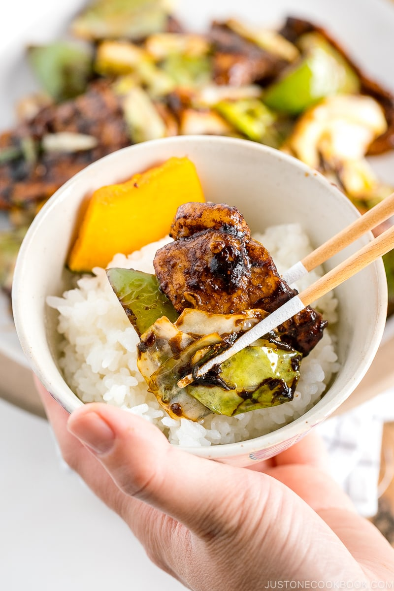 Twice cooked pork is placed on top of steamed rice.