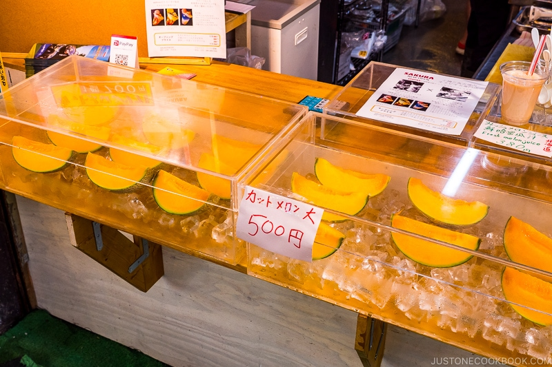 cut yubari melon on ice inside clear case