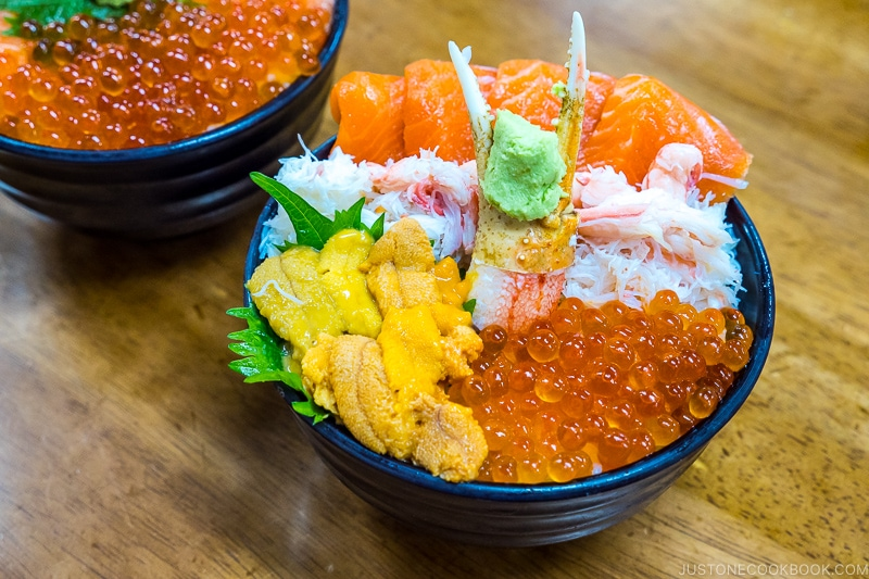 uni and seafood donburi on top of wood table