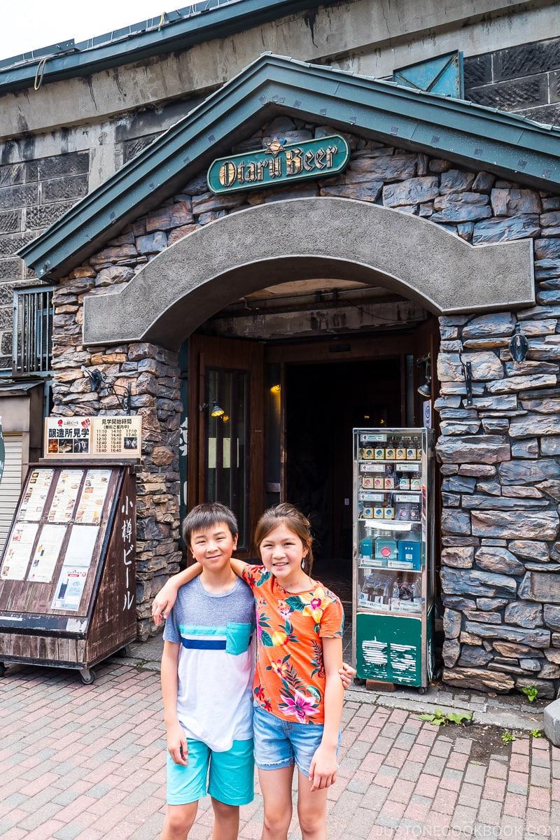 two children standing outside Otaru Beer