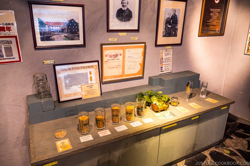 various hops on a countertop and historical framed photos on a wall