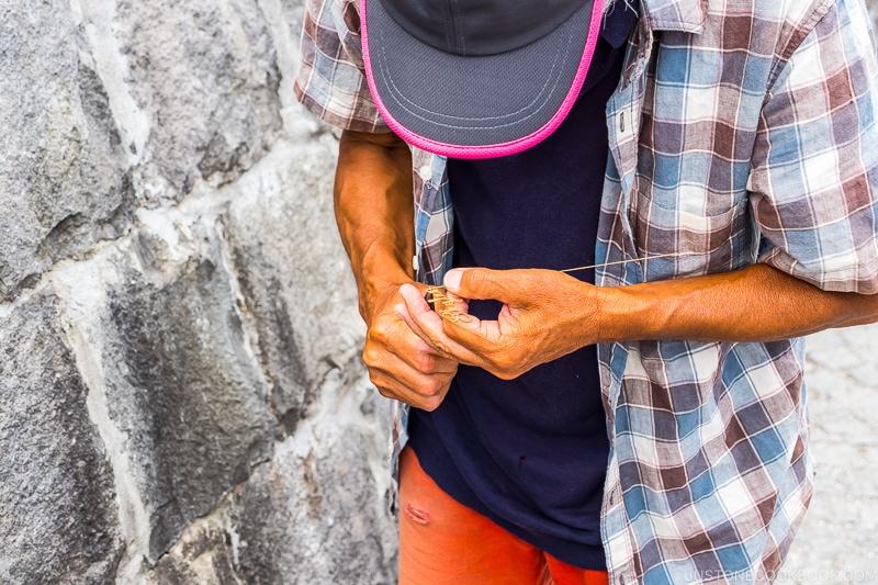 a street vendor making art work
