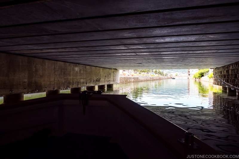 view of Otaru Canal from the cruise under the bridge