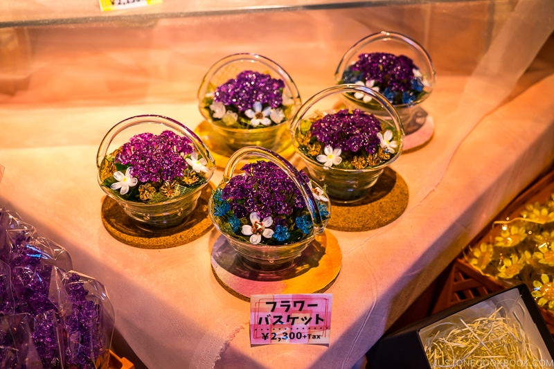 small decorative flower basket made with glass on a table