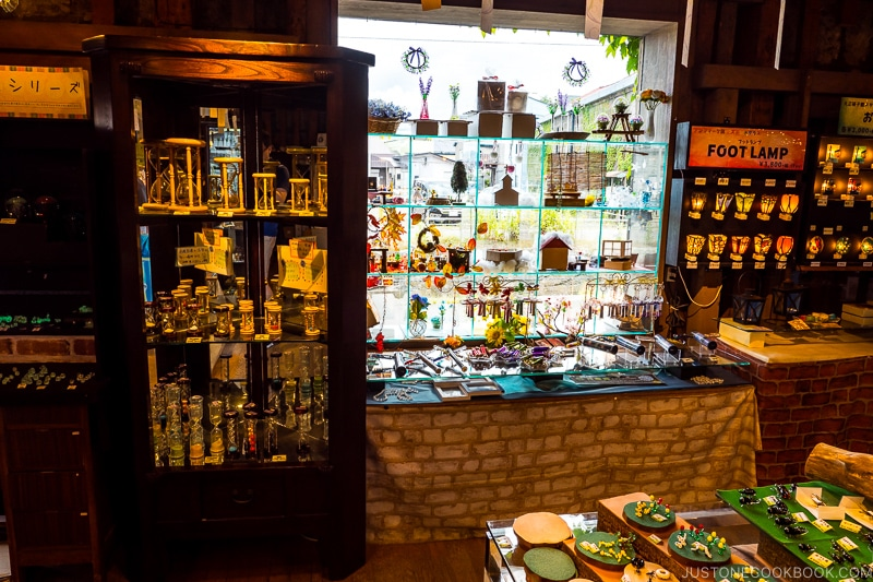 glass souvenirs inside cabinet and on display stands