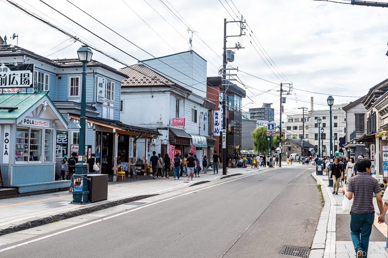 visitors walking on the sidewalks of a commercial street