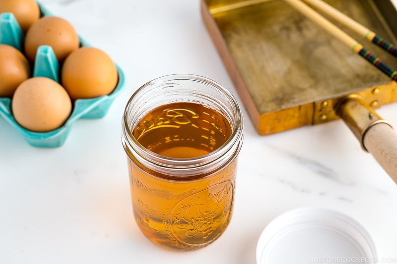 A mason jar containing sweet dashi.