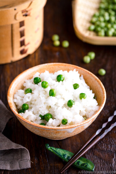 A ceramic rice bowl containing Mame Gohan (Green Pea Rice).