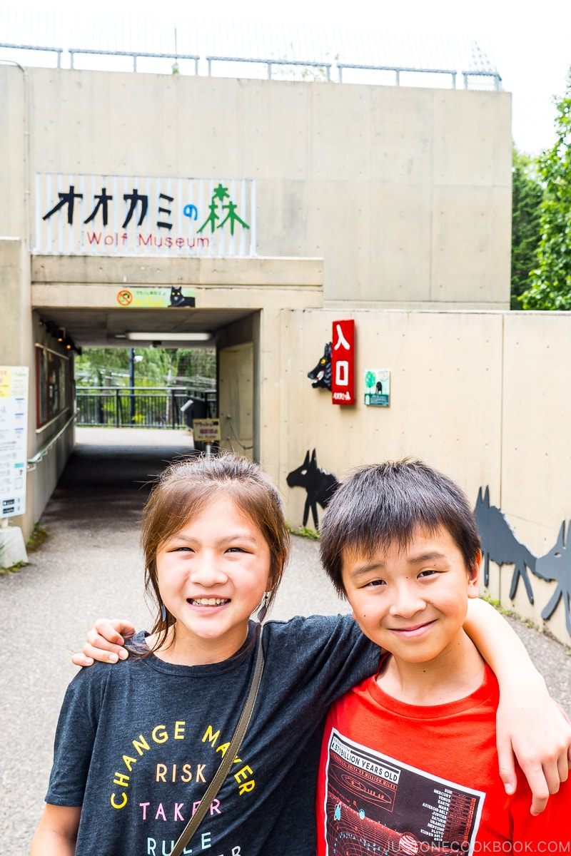 two children in front of the entrance to wolf museum