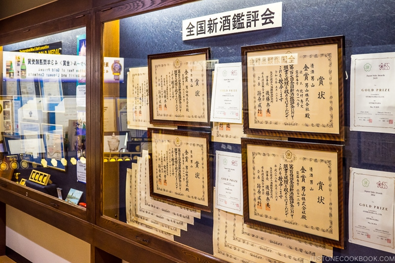 award certificates displayed on a wall
