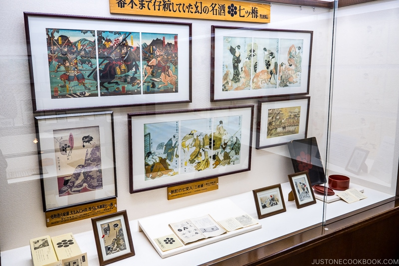 framed Japanese prints in a display case