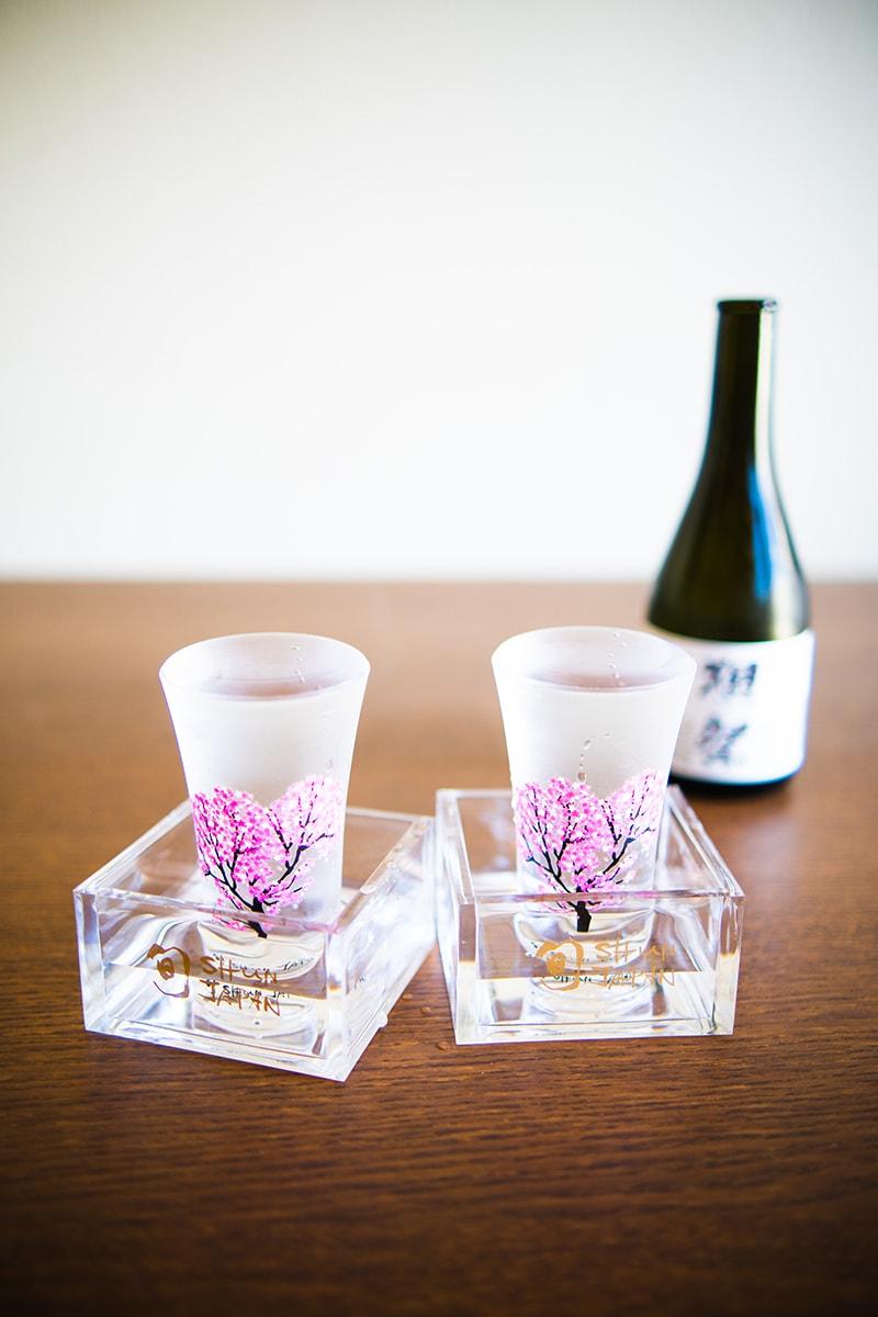 a set of sakura motif sake glass set
