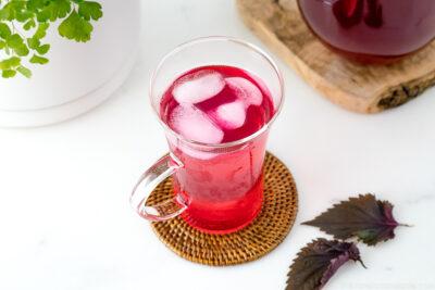 A glass containing Aka Shiso Juice.