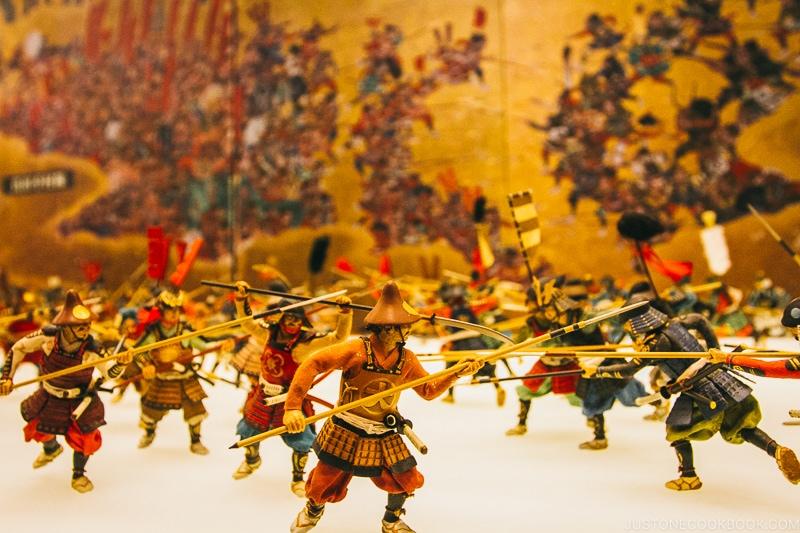 battle scene of miniature characters
