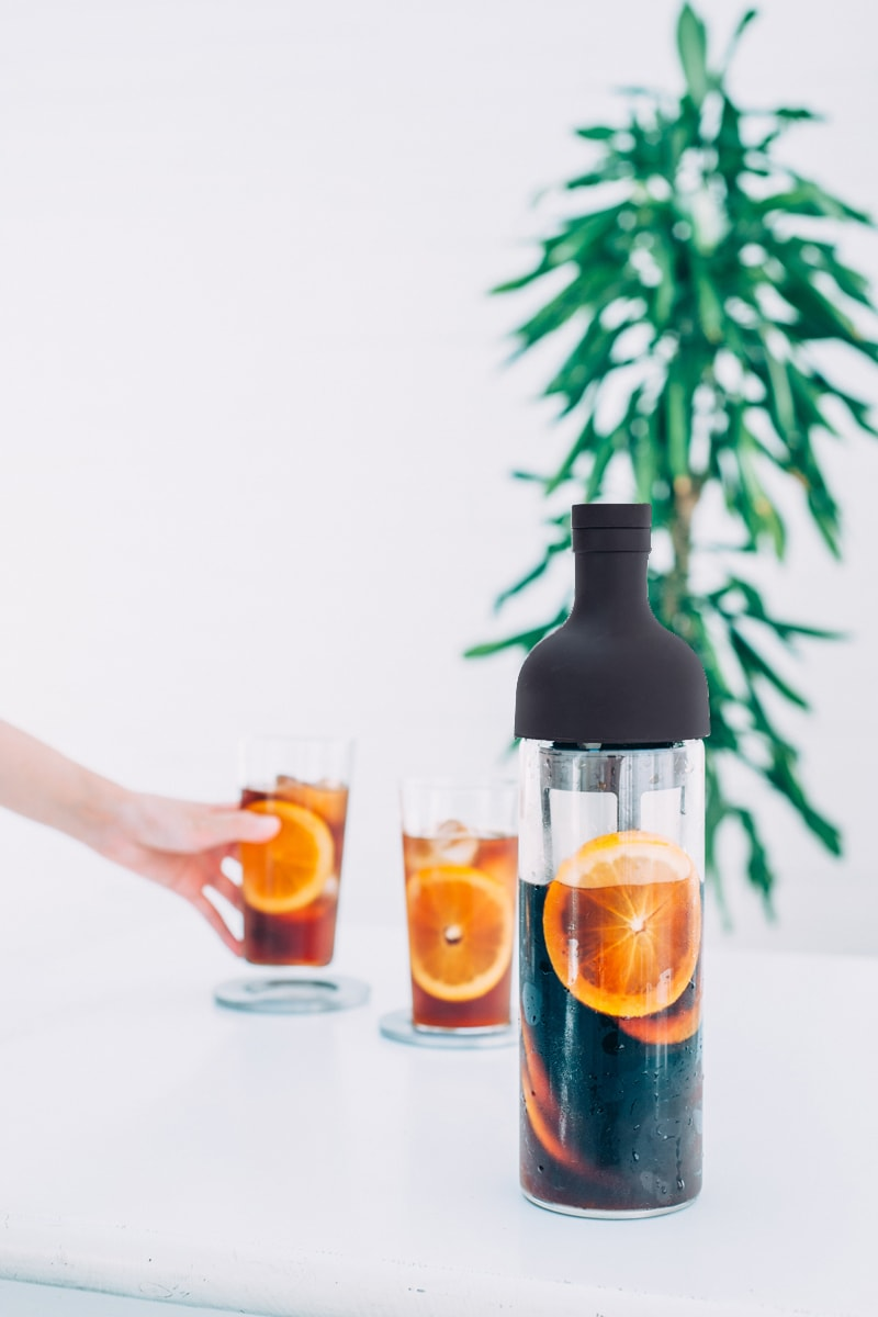 lifestyle action shot of Hario USA cold brew coffee wine bottle